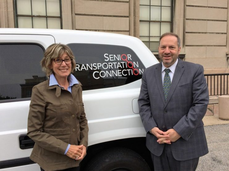 Mt. Sinai Board Chair Susan Ratner and President Mitch Balk check out one of STC's new MV1 vans.